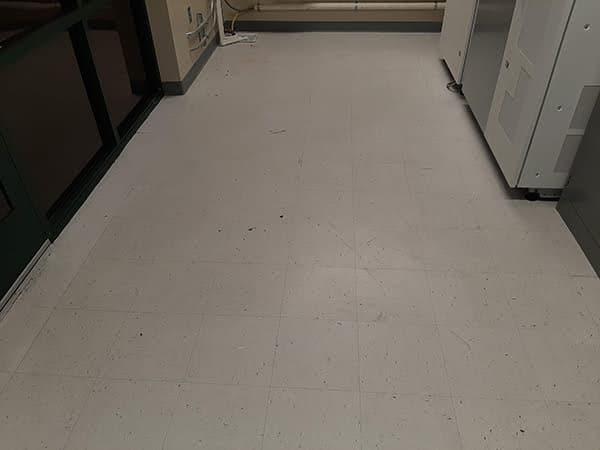 Dingy white tile floor before